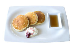 Buttermilk pancakes with maple syrup and weep cream in plate on Royalty Free Stock Photos
