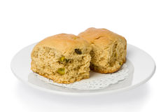 Buttermilk Rusks. Two south african style buttermilk rusks with pistachios on a small white plate Stock Images