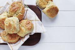Buttermilk Southern Biscuits Over White Table. Fresh buttermilk southern biscuits or scones over a white table shot from above. Top view stock image