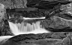Buttermilk Waterfall. A small waterfall in a stream flowing down rocks Stock Images