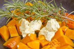 Butternut pumpkin in a pan with butter Stock Photo