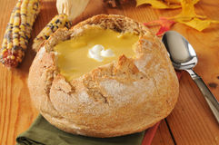 Butternut quash soup in a bread bowl Royalty Free Stock Image