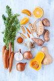 Butternut soup fresh raw ingredients. Raw ingredients for butternut soup, carrot onion ginger sweet potato chilli and orange Stock Photo
