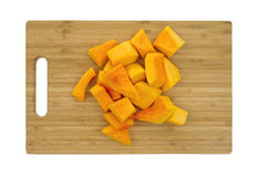 Butternut squash on cutting board Stock Images