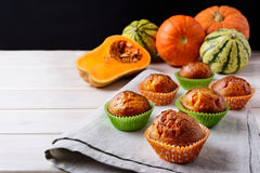 Butternut squash and honey muffins and ripe pumpkins Royalty Free Stock Photos