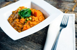 Butternut Squash Risotto. A butternut squash risotto served in a basic white bowl Royalty Free Stock Photography