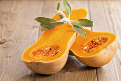 Butternut squash with sage leaves royalty free stock images