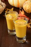 Butternut squash shooters. Butternut squash soup shooters with croutons on a holiday table Stock Image
