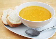 Butternut Squash Soup. Bowl of Butternut Squash Soup with Bread Slices Royalty Free Stock Images