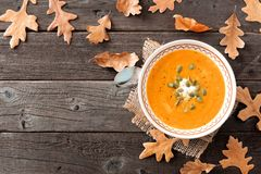 Butternut squash soup, overhead table scene with fall leaves Stock Photo