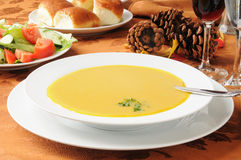 Butternut squash soup on a Thanksgiving table Royalty Free Stock Photo