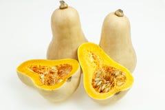 Butternutsquash bär frukt, en som klipps i halva Royaltyfri Fotografi