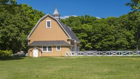 Butterscotch Barn. Butterscotch colored dairy barn in Hecksher Park, NY stock image
