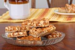 Butterscotch Peanut Bars. Plate of butterscotch peanut bars on a table stock photo
