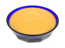 Butterscotch pudding in blue bowl Royalty Free Stock Photos