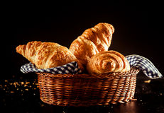 Buttery and Flaky Croissant on a Basket on a Table Royalty Free Stock Image