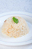 Buttery garlic rice with basil leaf Stock Photo