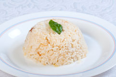 Buttery garlic rice with basil leaf Royalty Free Stock Image