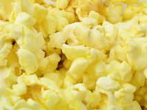Buttery Popcorn. Background of yellow buttery popped popcorn for use in scrapbooking, card making and stationery Stock Image