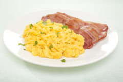 Scrambled Egg and Bacon Breakfast Stock Images