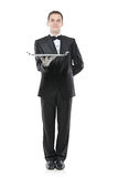 A buttler holding a tray. Isolated agasinst white background royalty free stock photos