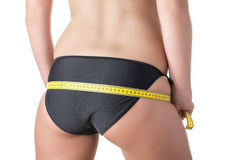 Buttocks with tape measure Stock Photos