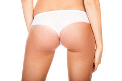 Buttocks in a white panties Royalty Free Stock Photo