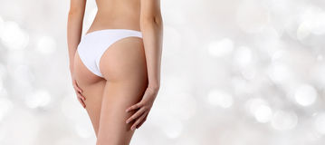 Buttocks woman  on blurred lights background Stock Photography
