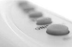 ON button. In foreground. Shallow depth of field. Focus on word Royalty Free Stock Photos