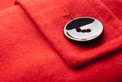 Button. Close-up of button on red coat Royalty Free Stock Images