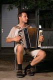 Button accordion playing evening serenade Stock Photos