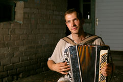 Button accordion playing evening serenade Stock Images