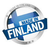 Button with Banner MADE IN FINLAND. Round button with banner, country flag and text MADE IN FINLAND Stock Image