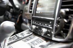 Button bar with multimedia device in a premium German sedan. headunit with sim card connector.  royalty free stock photography