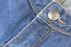 Button of blue jeans. Royalty Free Stock Images