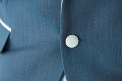 Button of blue suit and pocket royalty free stock photos