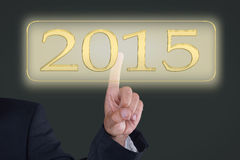 Button 2015. Businessman pushing button for 2015 Stock Images