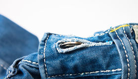 Button in button hole on jeans Royalty Free Stock Photography
