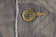 Button on camouflage jacket Stock Photography