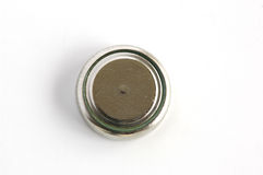 Button cell. Battery in background white Stock Image