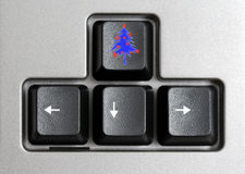 Button with Christmas tree. Computer buttons with arrow and one with christmas tree Royalty Free Stock Photo