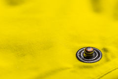 Button clasp. Close up of button clasp on yellow jacket Royalty Free Stock Photo