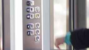 Button click in the lift stock video footage