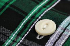 Button on a cloth Royalty Free Stock Photos