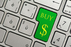 Button computer key enter buy. The image describes a computer keyboard, with the enter button colored green and the text buy, with under a symbol dollar Royalty Free Stock Image