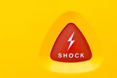 Button för att applicera en AED-shock Arkivfoto