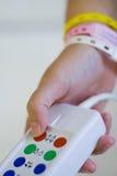 button felanmälanssjuksköterskan Royaltyfri Bild