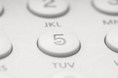 Button five. On white telephone keyboard, can be used as background Stock Images
