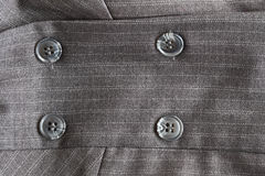 Button on a gray suit Royalty Free Stock Image