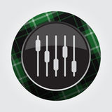 Button green, black tartan - equalizer symbol. Black isolated button with green, black and white tartan pattern on the border - light gray mixing console Royalty Free Stock Photography